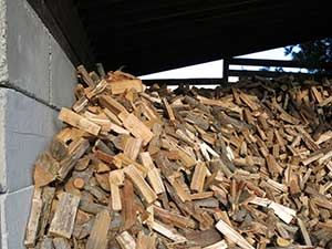 Our firewood is stored year round out of the elements.